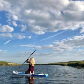 Eva Kristlova paddle boarding